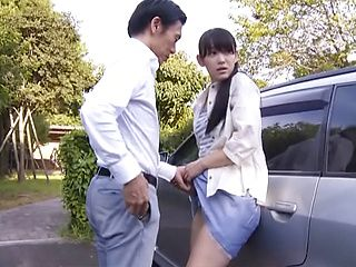 Enchanting Japanese AV model shows upskirt shots outdoors
