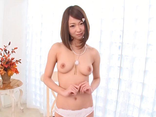 Amateur Yuka Yamaguchi gets nude and exposes shaved pussy