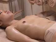 Delicious Asian girl gets her body massaged and pussy fingered
