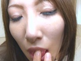 Busty Asian milf Yumi Mizuki masturbating on cam picture 9