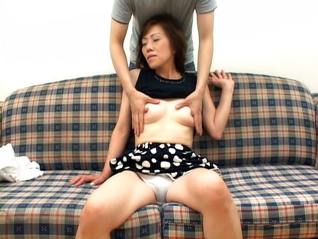 Mature Japanese lady gets tits fondled