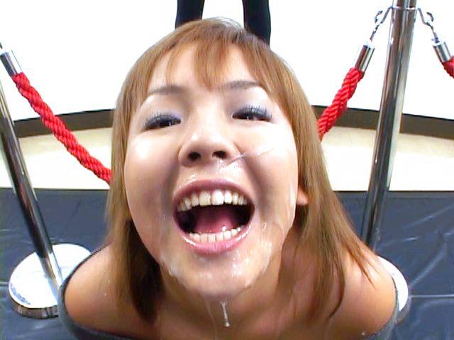 Asian babe in bukkake action