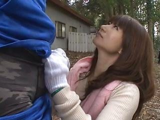 Kinky Japanese mature gives blowjob outdoors