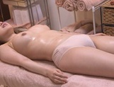 Kinky Asian AV model is oiled and gets fucked by horny masseur picture 15