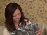 Busty Natsumi Shiraishi puts on school uniform for sex