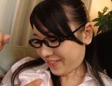 Lusty Asian babe Riko Komori deals with two large cocks picture 11