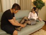 Lusty Asian babe Riko Komori deals with two large cocks picture 1