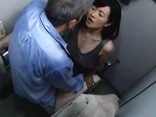 Unsatisfied Japanese mature lady enjoys stand fucking in public place