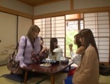 Steaming Japanese milfs swim in a pool and give a group blowjob