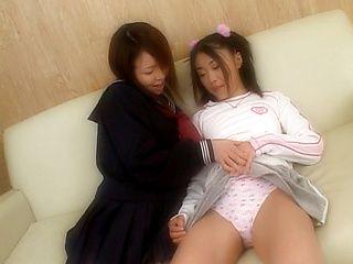 Lovely Japanese schoolgirl has lesbian sex