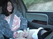 Passionate Asian married woman Ayumi Shinjyou masturbates in a car