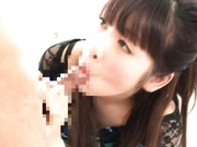 Rico Yamaguchi is a crazy babe who likes having two rods in her mouth.