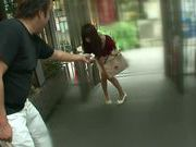 Red dressed volyball Japaneses girl is giving a blowjob in public place
