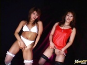 Two Japanese Models In Stockings Show Their Pussies