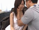 Hitomi Oki gets her big hairy pussy pounded doggy style