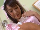 Pretty and busty maid Hitomi Oki in uniform pussy fondled and banged from behind picture 2