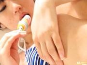 Yuri Haruki sucks on a big lollipop naked
