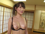Rina Yada sexy Asian girl in black lingerie gives a handjob