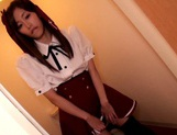 Schoolgirl Eiro Chika Gives A Footjob In Black Thigh High Stockings picture 1