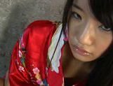 Mizumi Maki Asian model plays with a huge dildo picture 12
