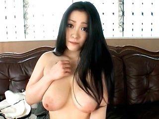 Minako Komukai shows off her massive tits and hairy pussy