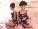 Nice Teen Emiri Suzuki masturbates with a blue vibrator in bathroom