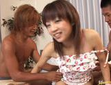 Sexy Japanese milf Ami Kitazawa gets gangbanged by two horny boys. picture 2
