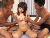 Sexy Japanese milf Ami Kitazawa gets gangbanged by two horny boys.
