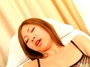 Anna Kousaka is a busty Asian in black stockings that loves sex toys.
