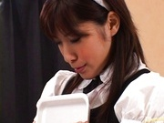 Hot maid Riko Tachibana masturbates herself with a big dildo.