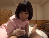 Naughty Asian nurse Yuu Shinoda gives a foot job and bounces on cock picture 13