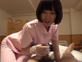Naughty Asian nurse Yuu Shinoda gives a foot job and bounces on cock picture 14