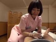 Naughty Asian nurse Yuu Shinoda gives a foot job and bounces on cock