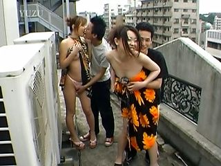 Two girls and two guys have a wild orgy on the rooftop