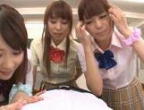 Three sweet Japanese school girls suck on one throbbing cock and eat cum picture 11