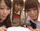 Three sweet Japanese school girls suck on one throbbing cock and eat cum picture 13
