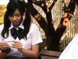 Cute schoolgirl Nana Ogura plays with herself in the park. picture 1