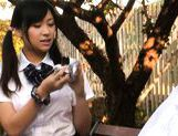 Cute schoolgirl Nana Ogura plays with herself in the park.