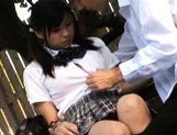 Cute schoolgirl Nana Ogura plays with herself in the park. picture 7