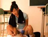 Sexy schoolgirl Nana Ogura msturbates a big cock with her feet. picture 4