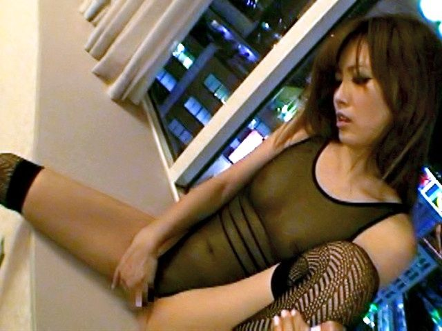 Rina Kato Lovely Asian model in a sexy fishnet suit