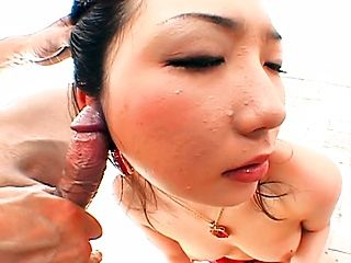 Big Titted Japanese Chick On Her Knees Sucking Dick