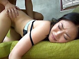 Black haired Japanese beauty gets a cum facial