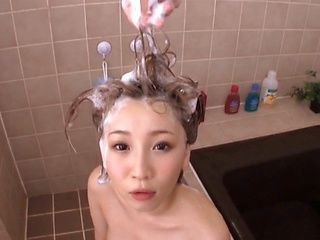 Hot MILF Mei Kago gives a POV blowjob in the bathroom