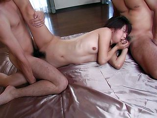 Crazy hot milf Bunko Kanazawa sucks two cocks in a gangbang.