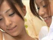 Two hot Asian lesbians sharing cock!