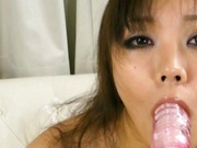 Kinky babe Hinata Komine masturbates in the bathroom and sucks a vibrator.