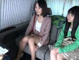 Two delicious Asian babes have threesome sex in a car picture 13