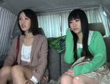 Two delicious Asian babes have threesome sex in a car picture 14