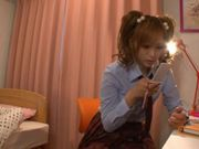 Cute young Japanese schoolgirl gets a delivery of sex toys to play with